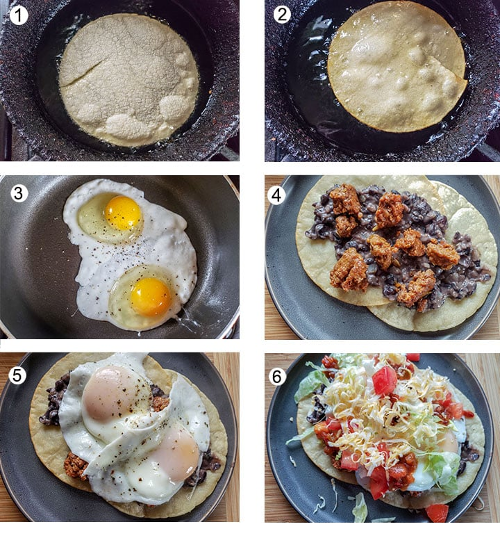 Heating tortilla in oil. Flipped tortilla. Frying 2 eggs. Beans and chorizo spread on tortilla. Eggs topping tortillas. Garnishes added.