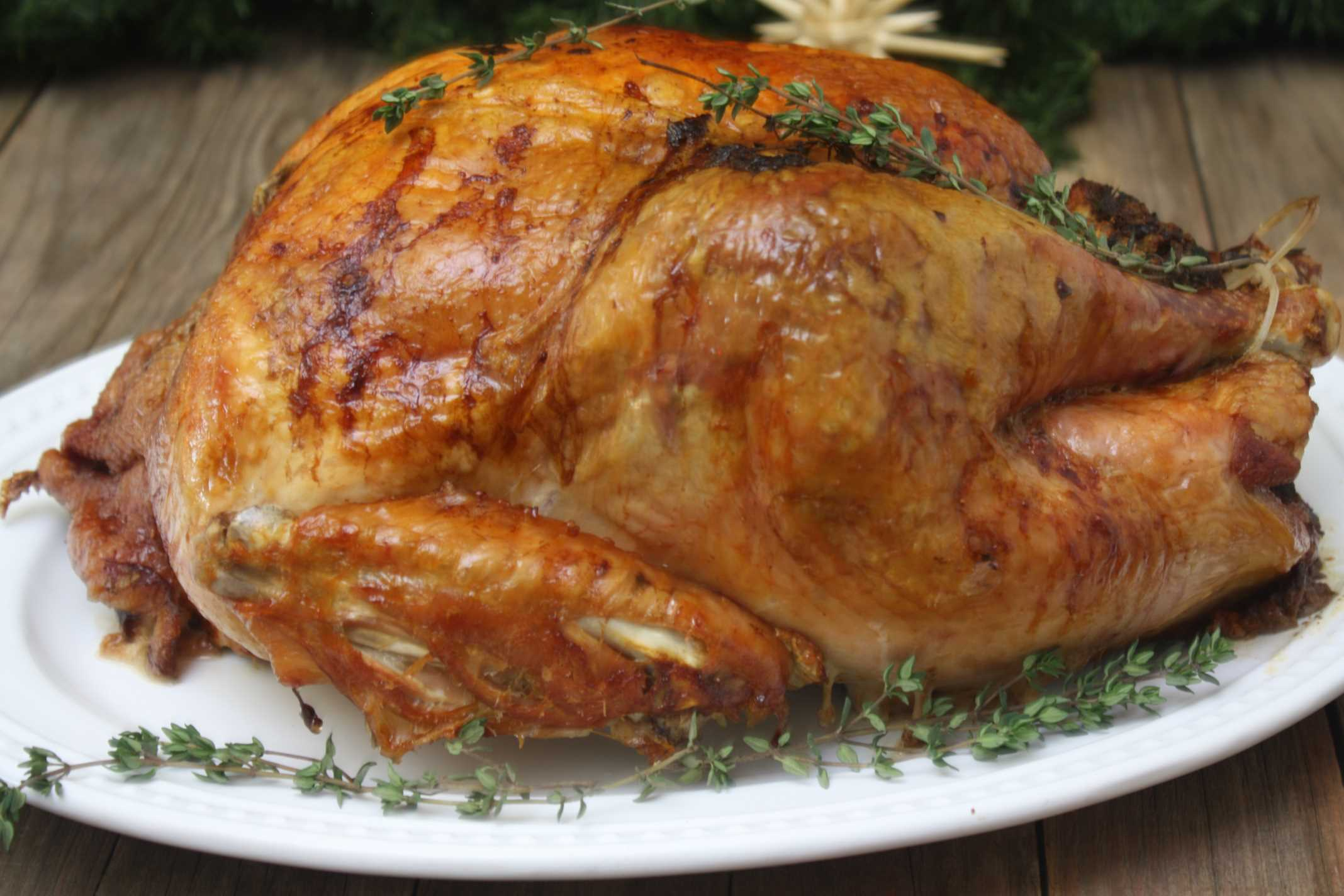 Roasted Turkey on platter with herbs