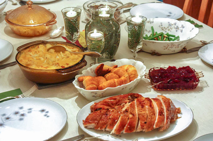 Table with holiday meal just before serving.