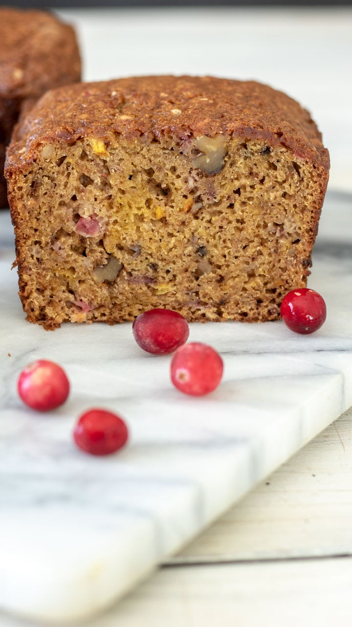 Close up of pumpkin quick bread with cranberries.
