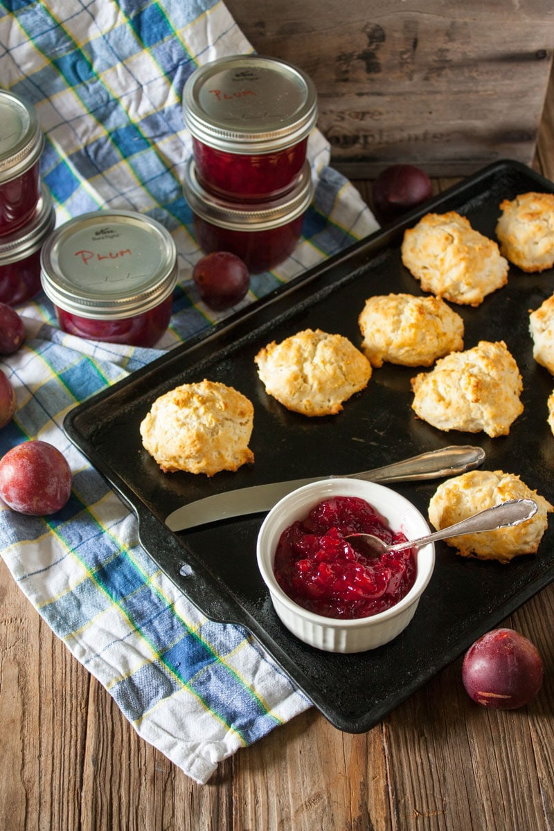 plum jam on metal baking tray with biscuits