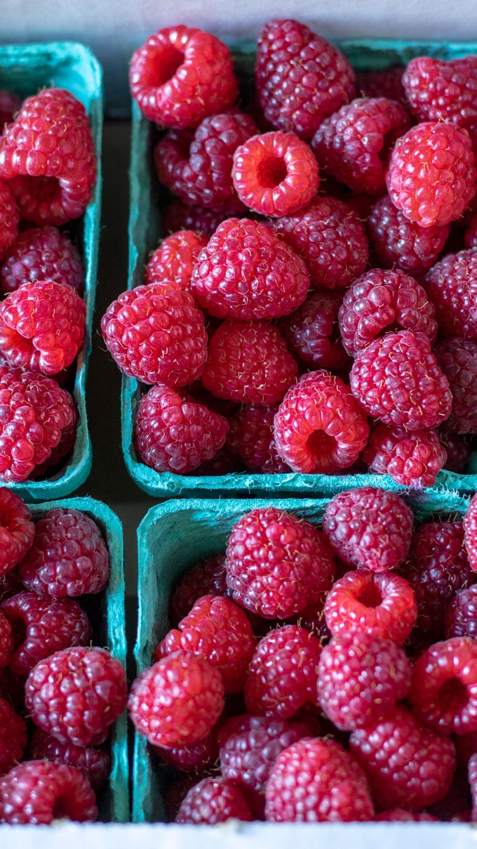 Close up fresh raspberries in baskets.