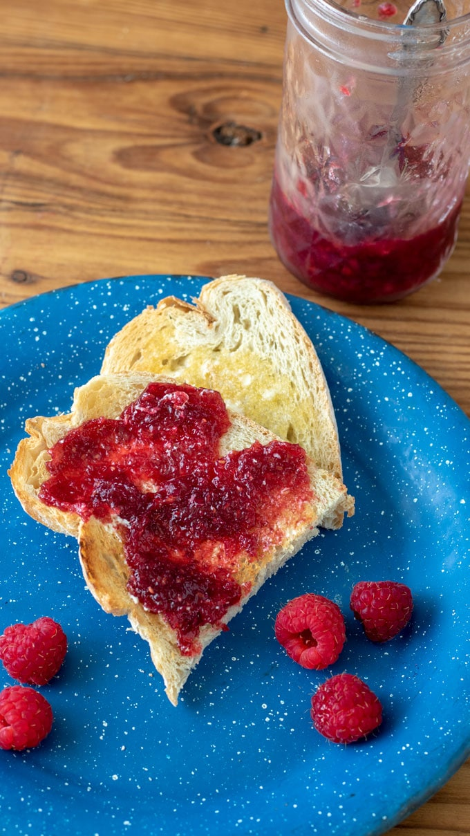 Raspberry jam spread on toast.