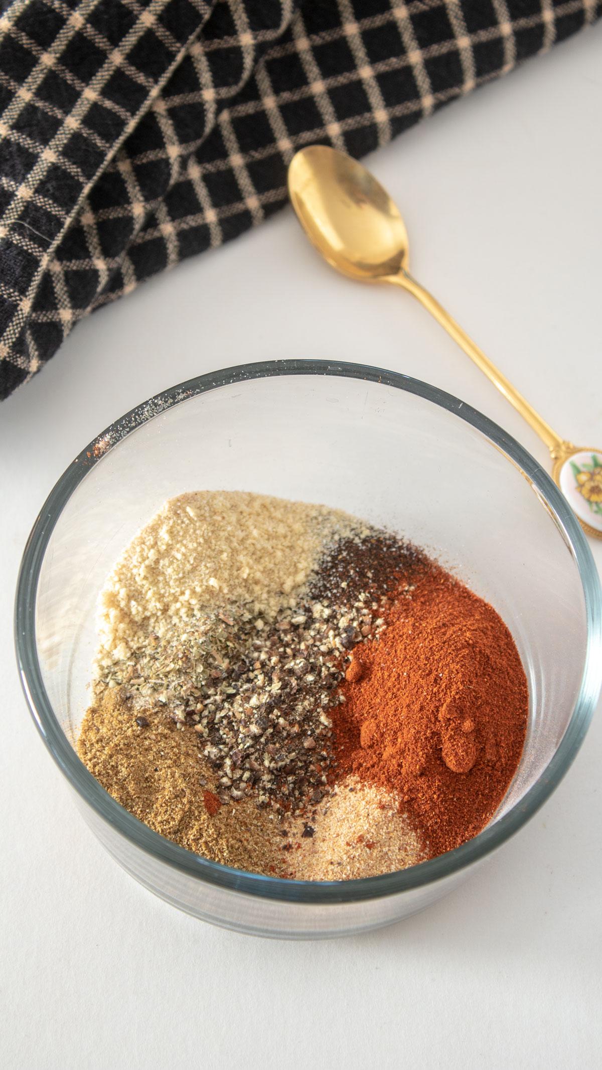 Adobo seasoning ingredients in small glass ramekins.