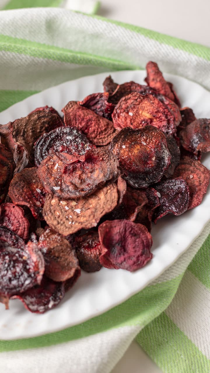 White platter loaded with beet chips.