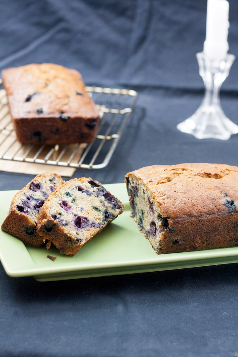 banana blueberry bread slices on green rectangular plate