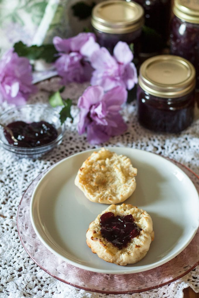 blackberry jam with muffin on white plate