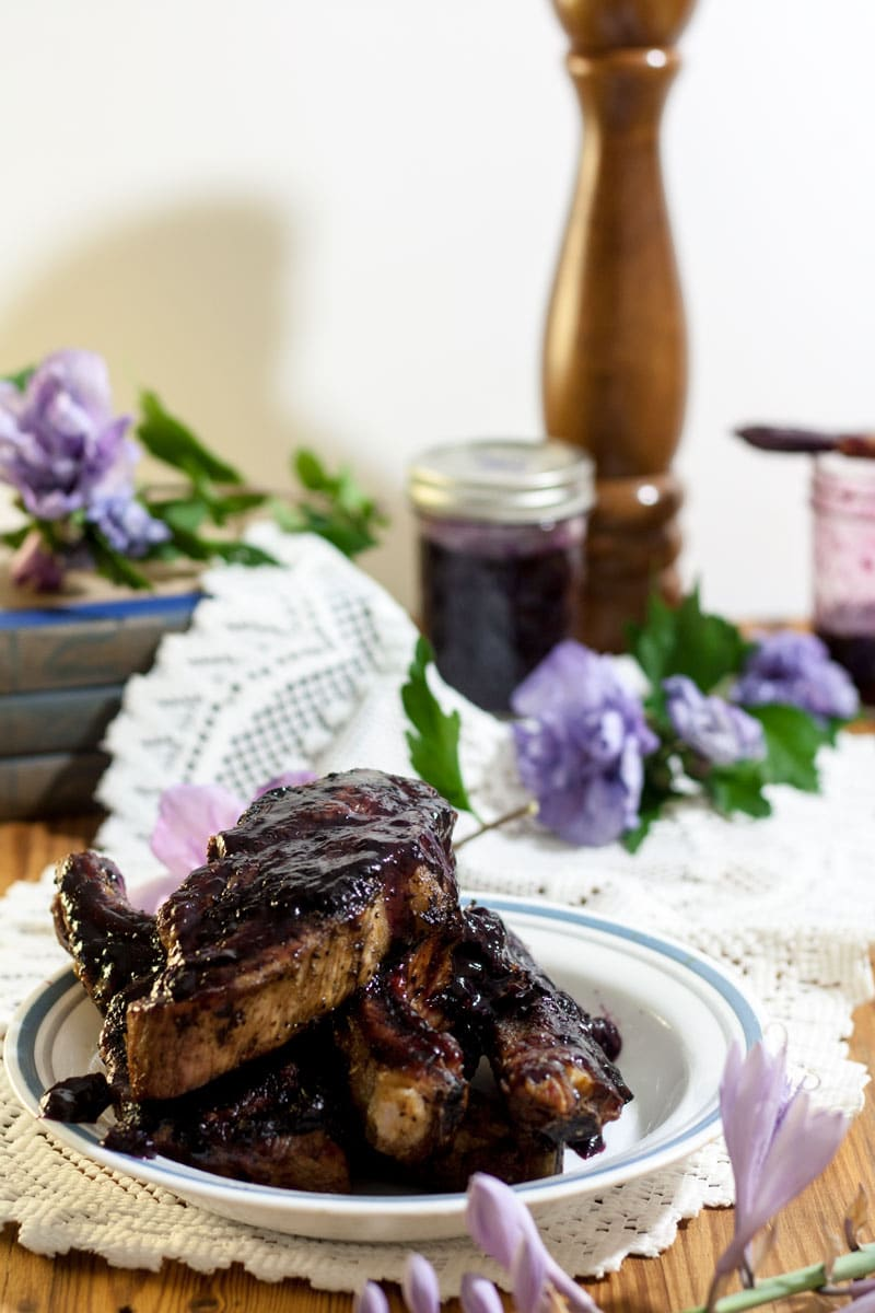 country ribs on white plate with purple flowers