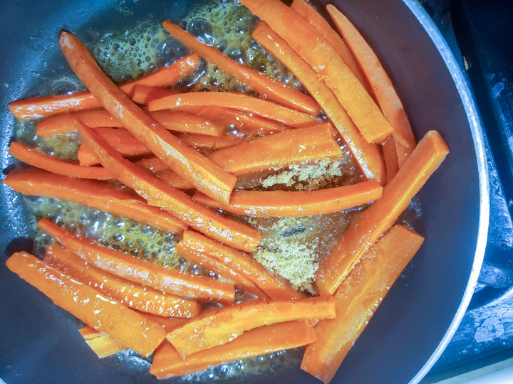 Browning carrots in pan.