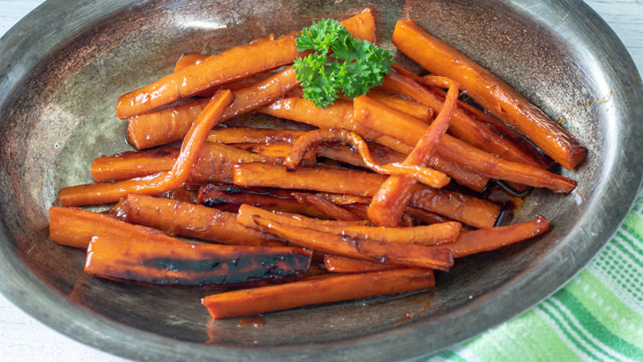 Glazed carrots on antique silver serving platter.