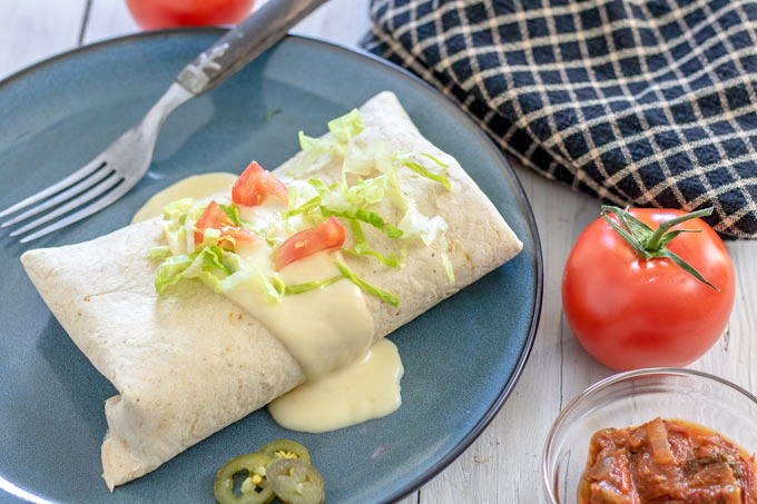 whole burrito with cheese sauce