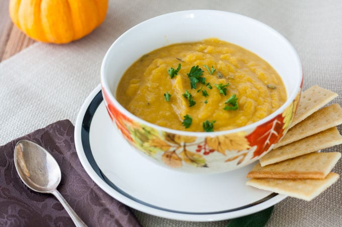butternut squash soup with parsley garnish