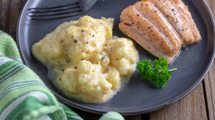 Cauliflower on gray plate with salmon filet