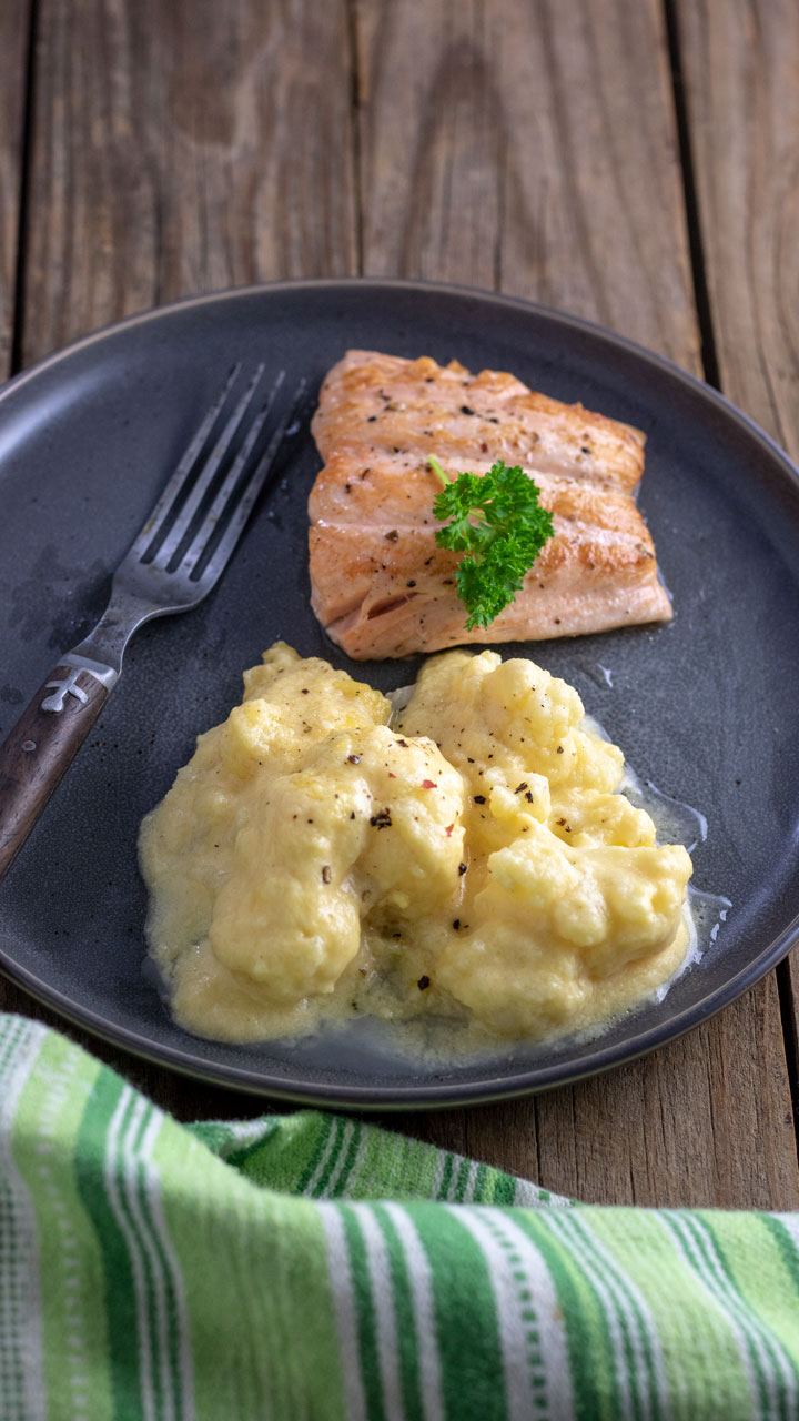 Cauliflower and cheese sauce with salmon.