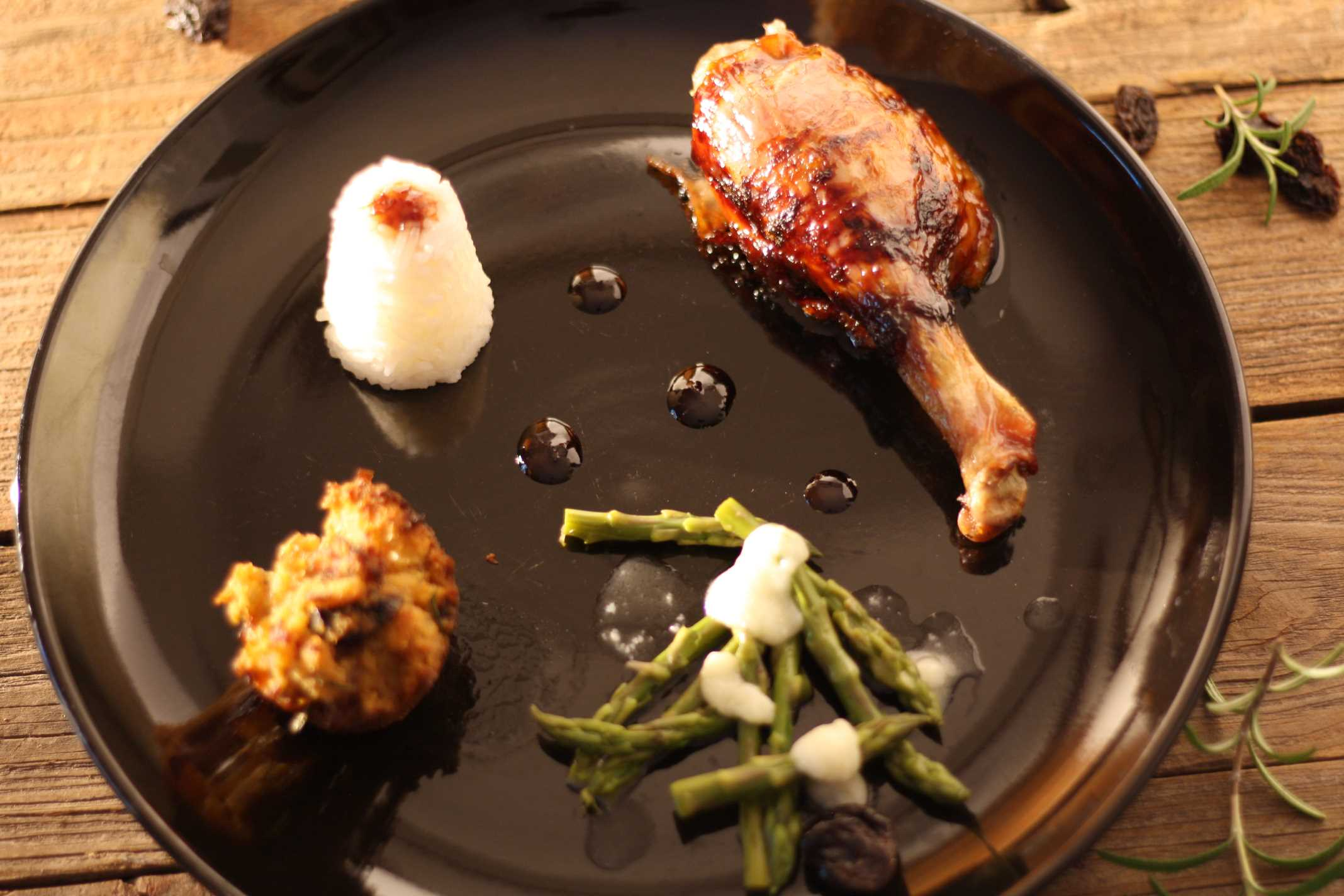 duck leg on black plate