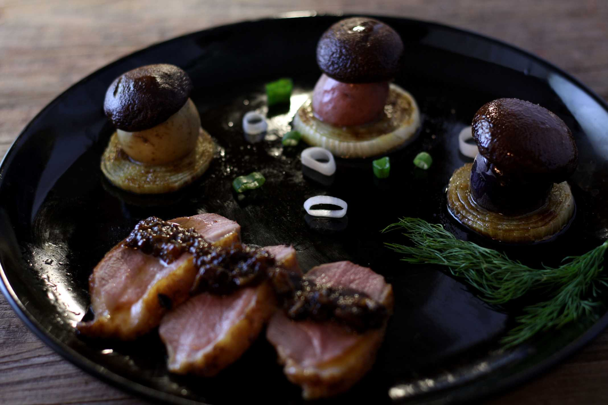 sliced duck breast with mushrooms