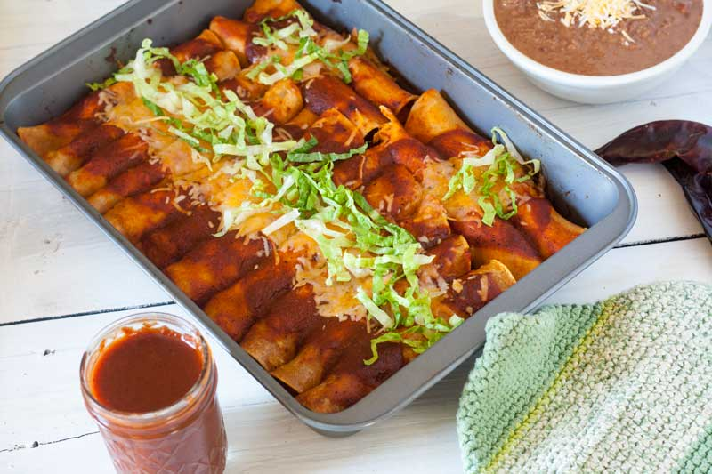 tray of easy chicken enchiladas with refried beans