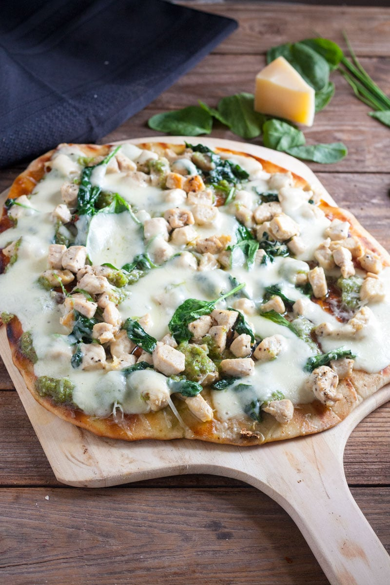 Chicken Florentine Pizza on wooden peel