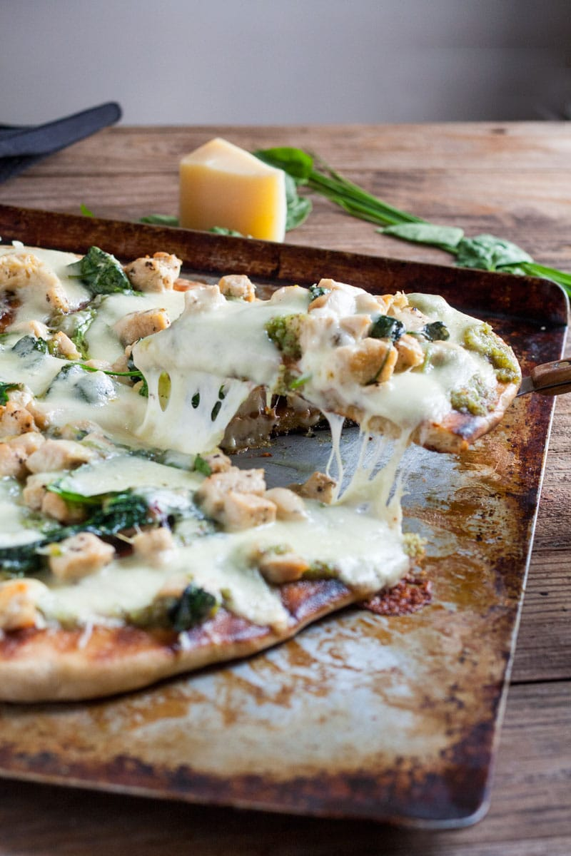 Chicken Florentine Pizza cut on baking sheet