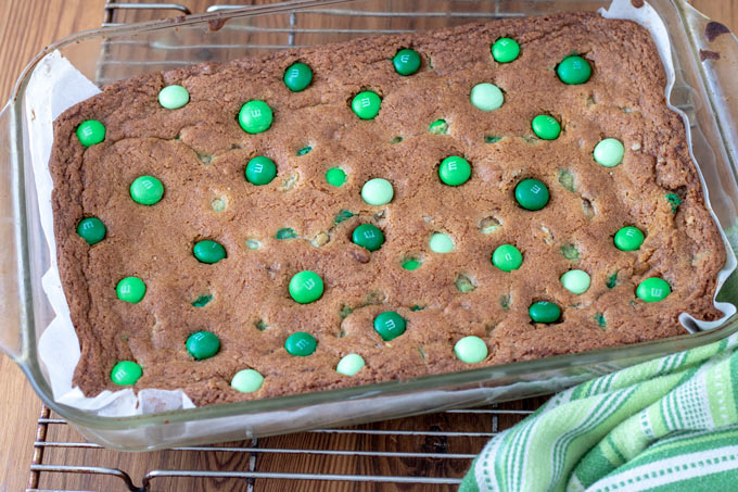 M&M cookie bars in glass baking pan