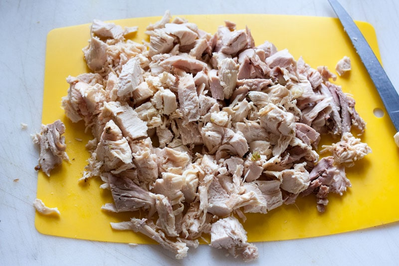 chicken diced on yellow cuuting board