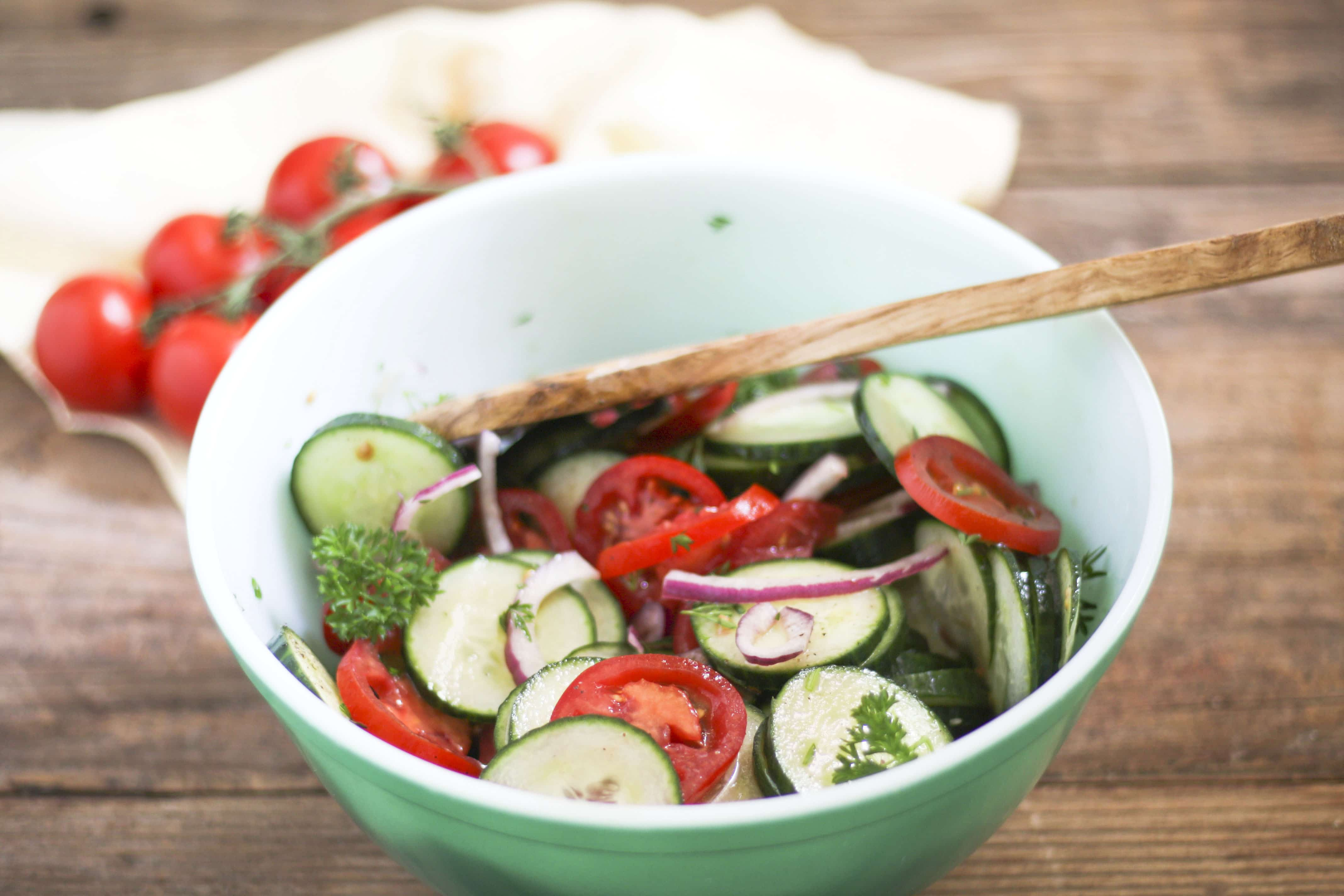 sliced cucumbers and tomatoes in Cucumber Tomato Salad
