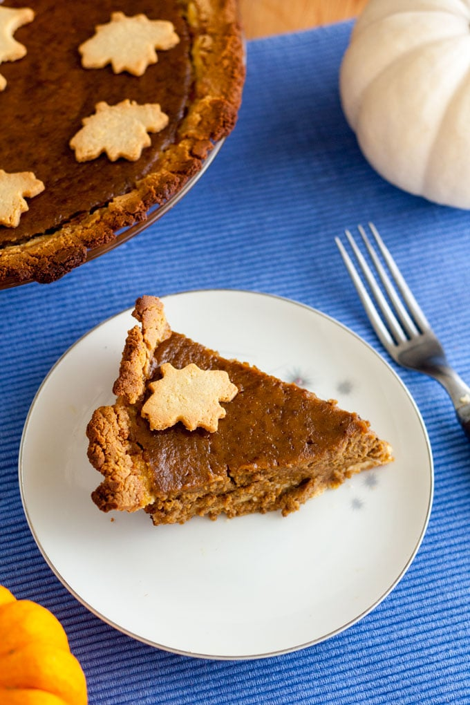 slice dairy free pumpkin pie on white plate