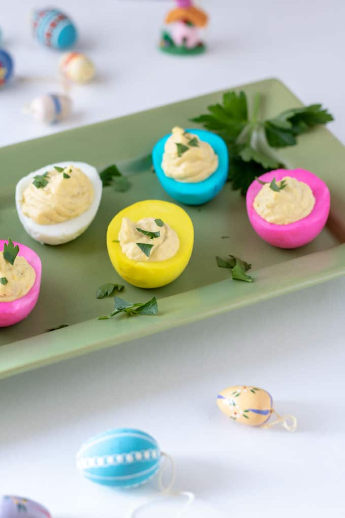 blue, pink and yellow colored deviled eggs