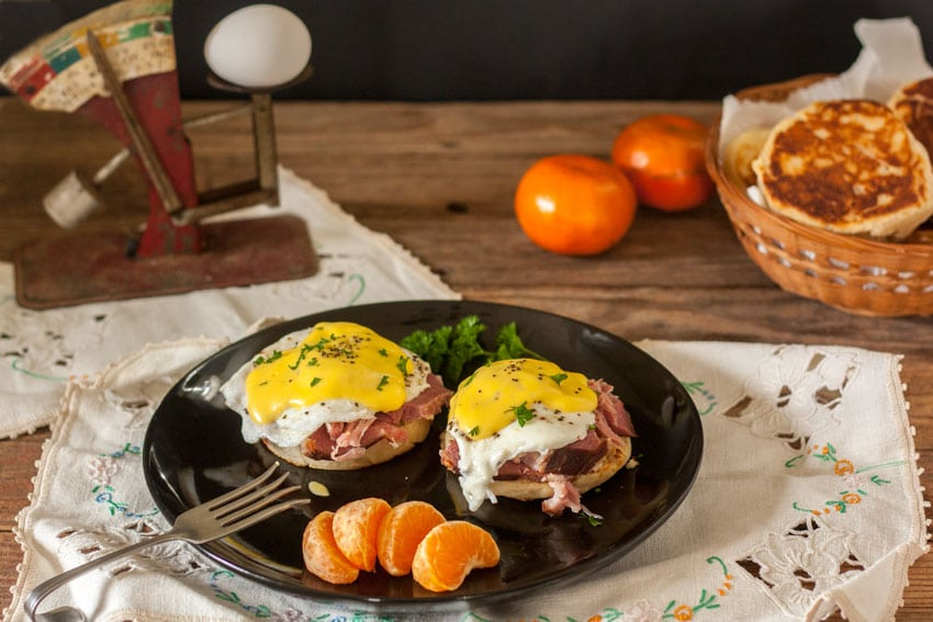 eggs benedict with parsley and orange garnish