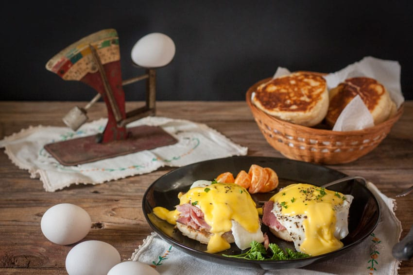 Black plate with eggs benedict recipe on it