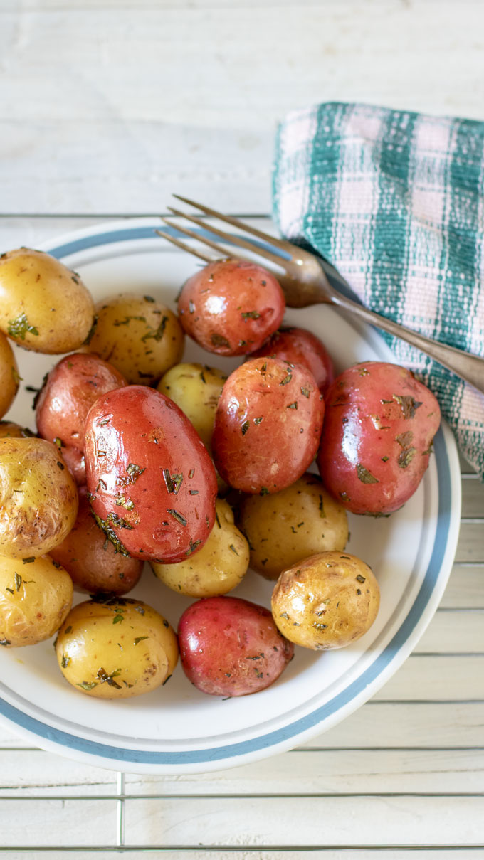 grilled potatoe on white plate.