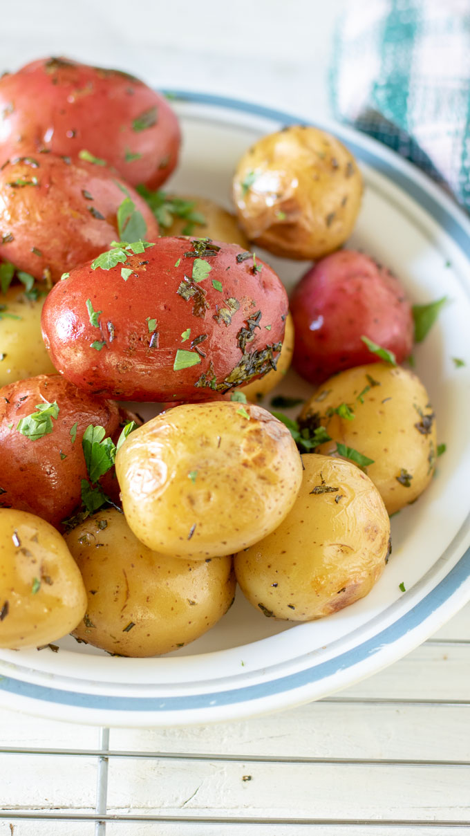 Red and yellow potatoes on white plate with blue rim