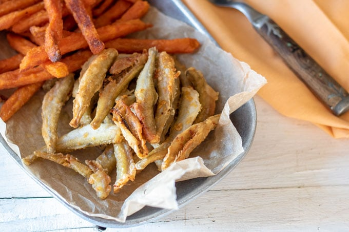 Smelt on pewter dish with sweet potato fries