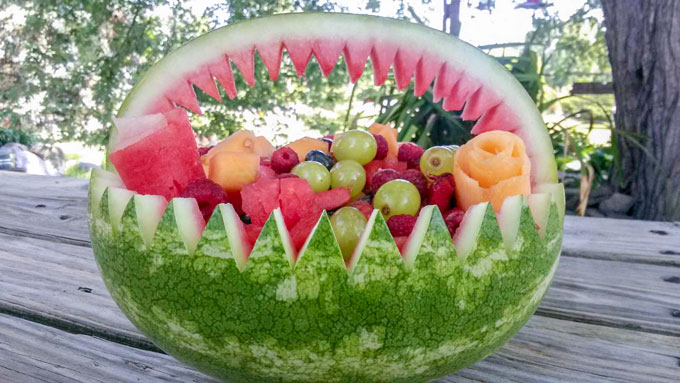 Fresh fruit salad in watermelon basket