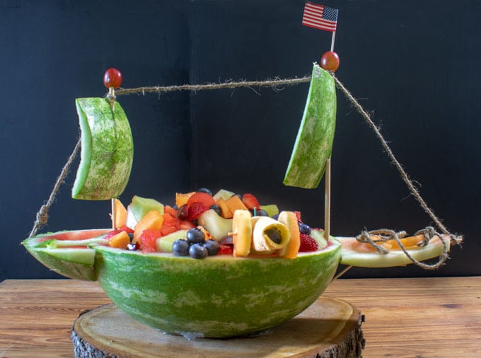 fruit salad served in watermelon ship