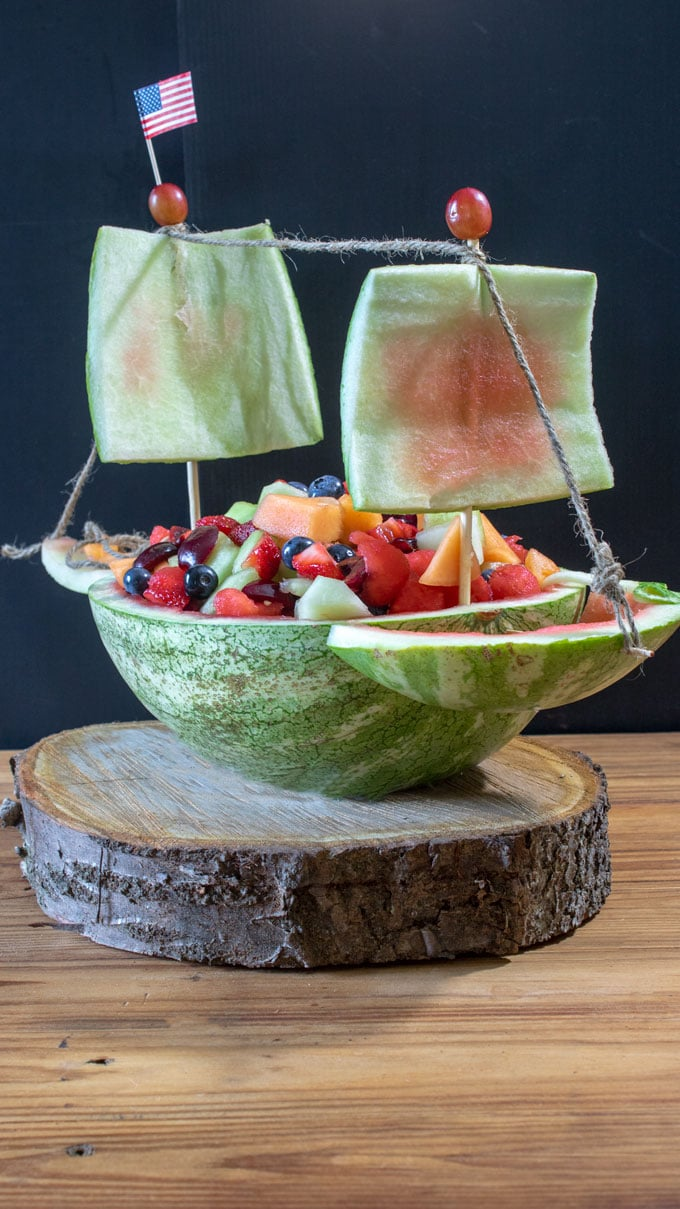fruit salad in carved ship
