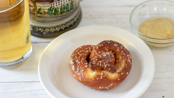 German pretzel on white plate.