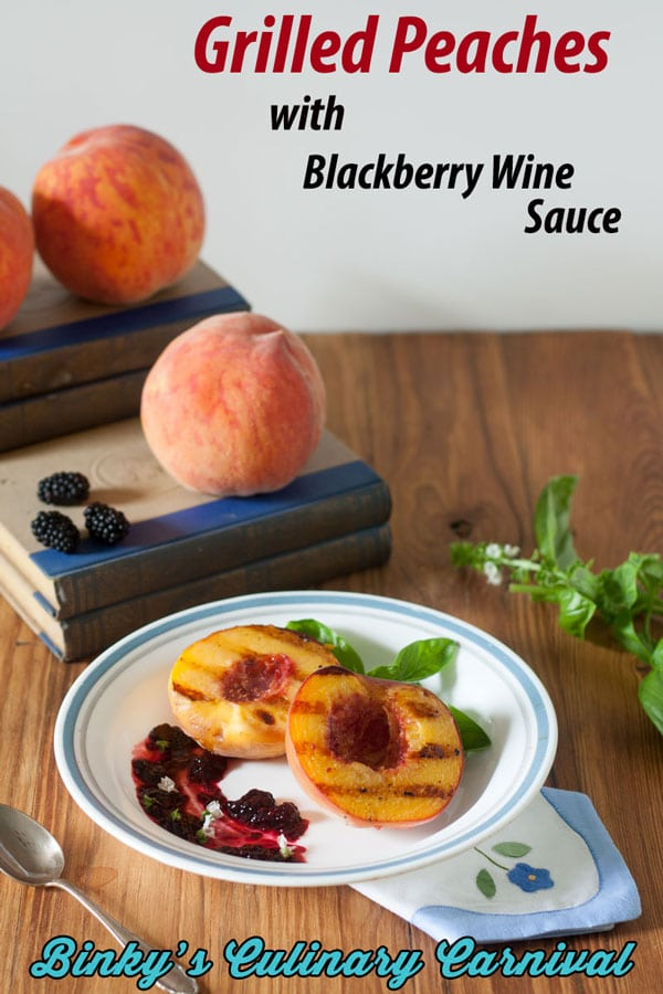 grilled peaches with grill lines and blackberry sauce on white plate with blue trim