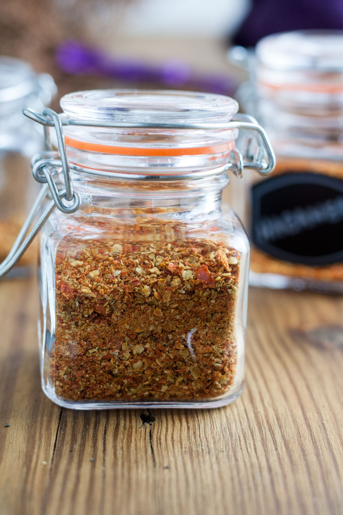 close up of square glass jar with chili powder