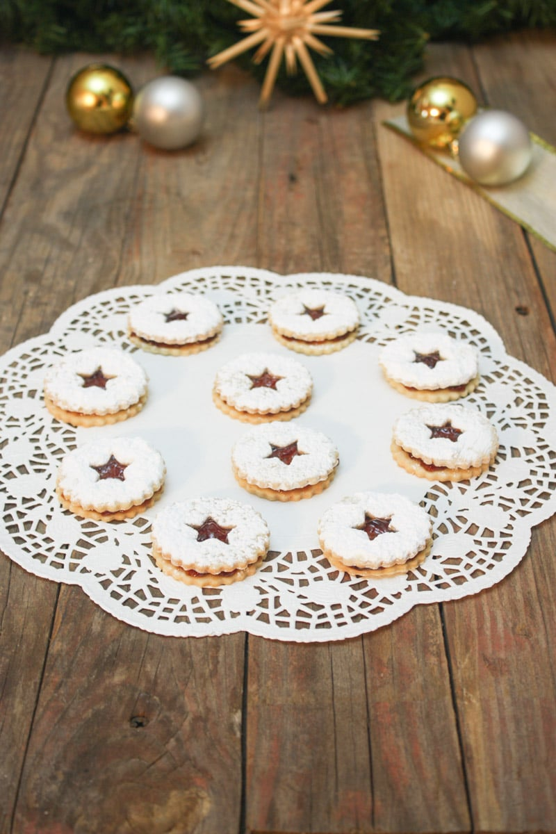 powdered sugar sprinkled cookies on doily.