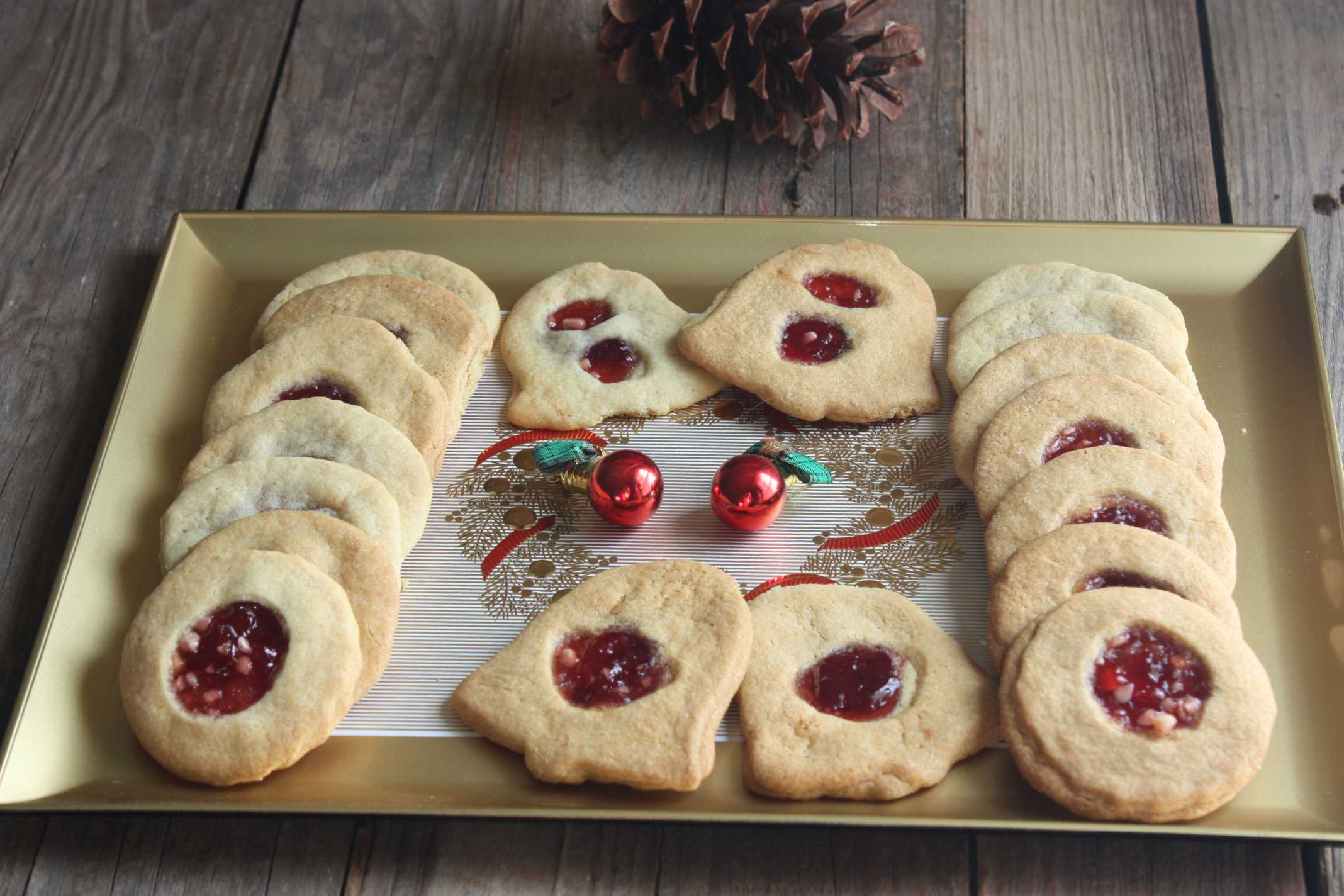 Jam filled cookies on Gold and Red Christmas serving tray