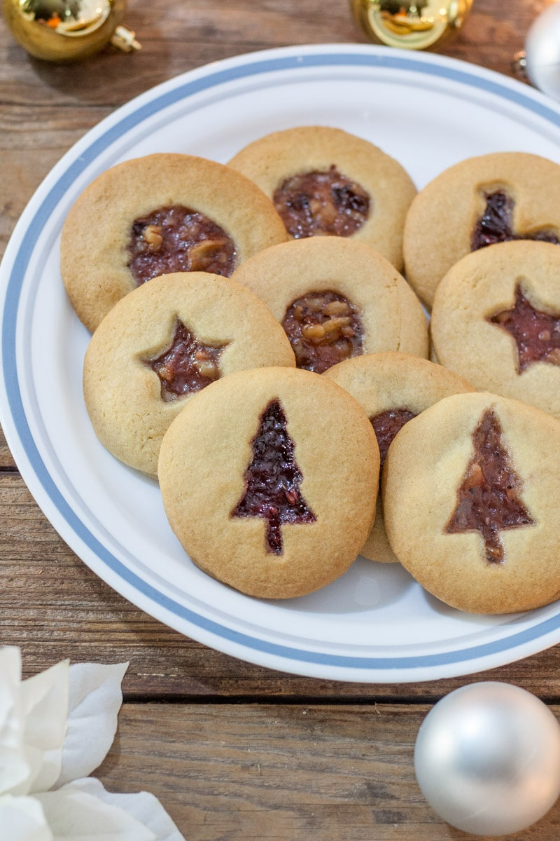 Jam filled cookies with Christmas Tree cutout, star cutout and circle cut out