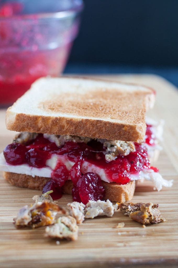 whole turkey sandwich dripping with cranberry sauce