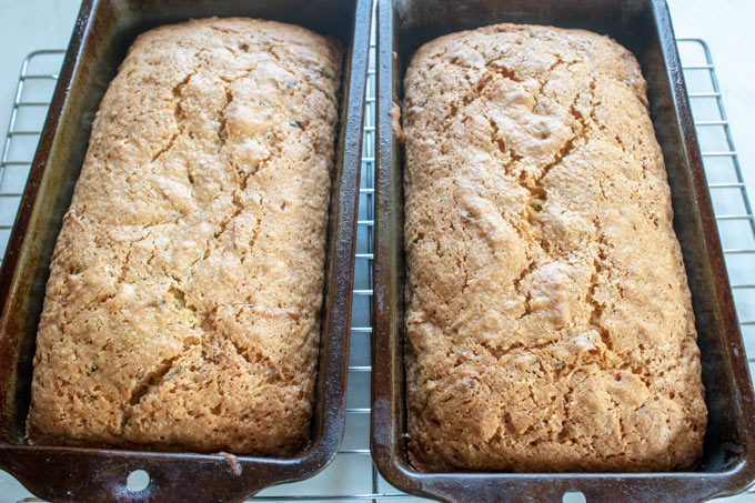 lemon zucchini breads in baking pans without glaze