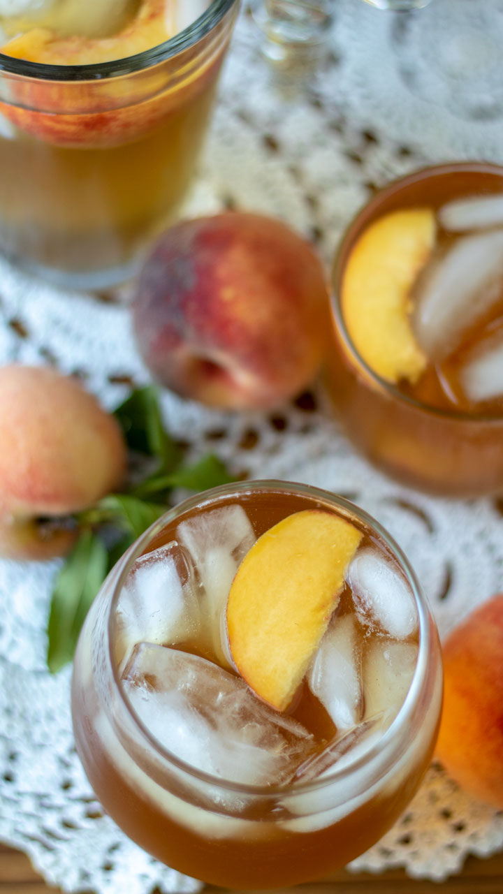 Overhead photo of glass of peach tea