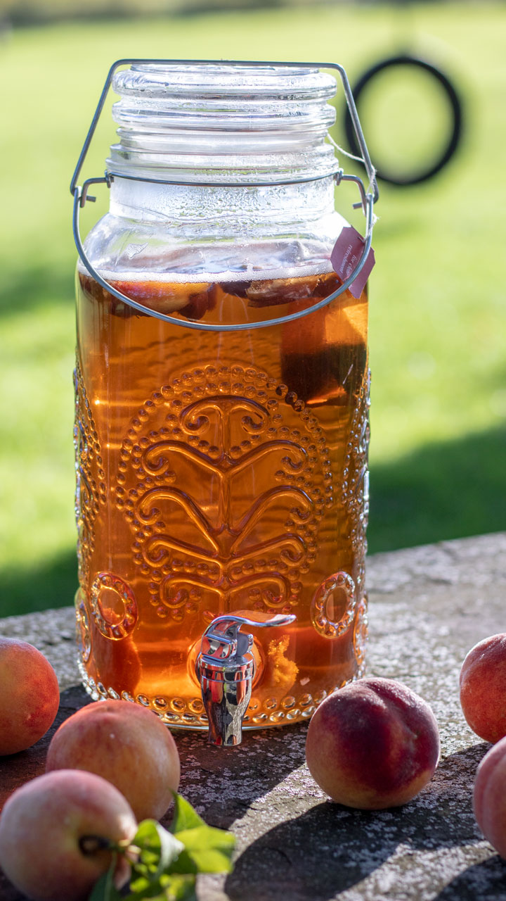 glass beverage dispenser with peach tea