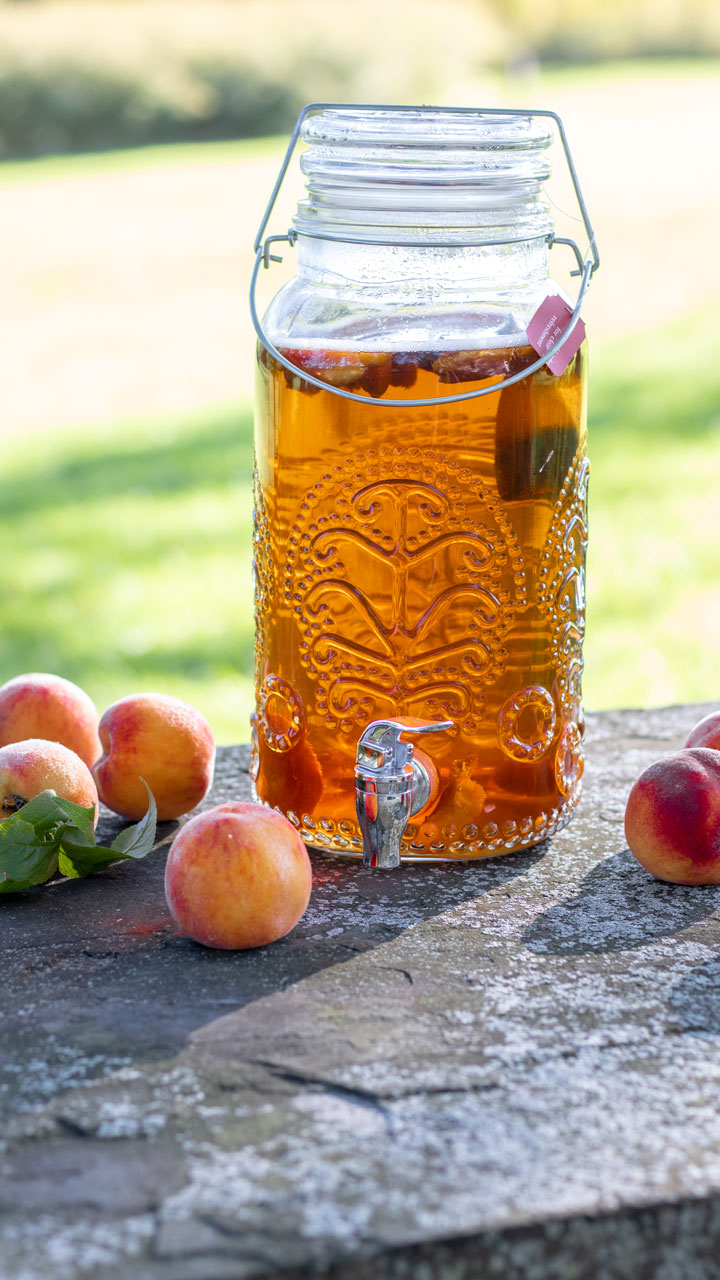 Beverage container with peach tea outside