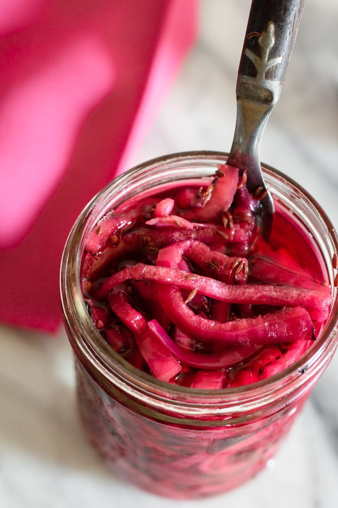 overhead view of pickled red onions in jar