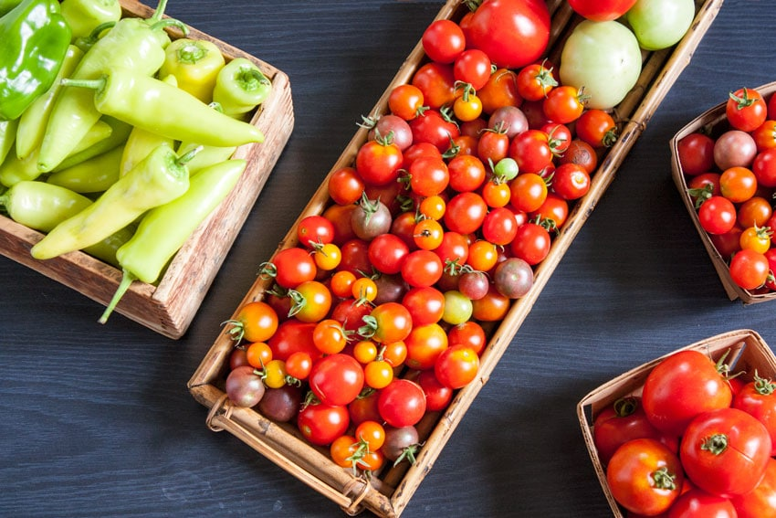 cherry tomatoes and peppers in baskets