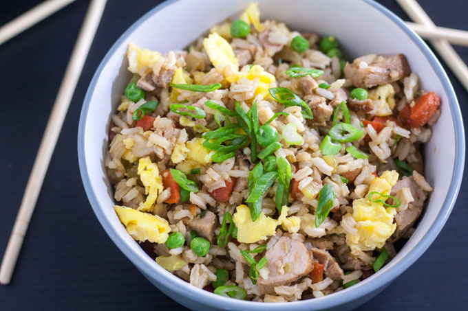 bowl of pork fried rice on black background